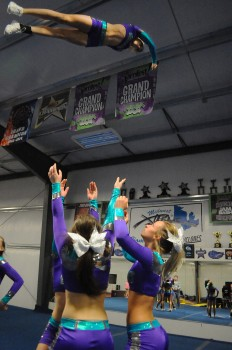 The Midwest Xtreme C4 competition cheer team show off their aerial exploits.