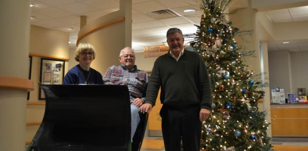 Pictured from left: Mary and Lee Hartle, Mayor Joe Thallmer. The Hartles donated their sled to Warsaw.