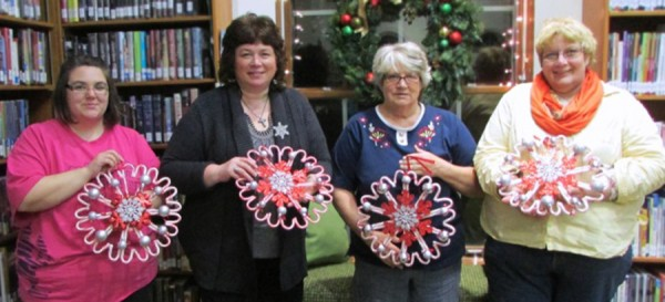 These ladies had lots of fun creating their candy cane wreaths on Monday, Dec. 8 at Adult Craft Night! Pictured: Patricia Zartman, Kelly Engle, Ruby Thompson, and Jackie Yunder.
