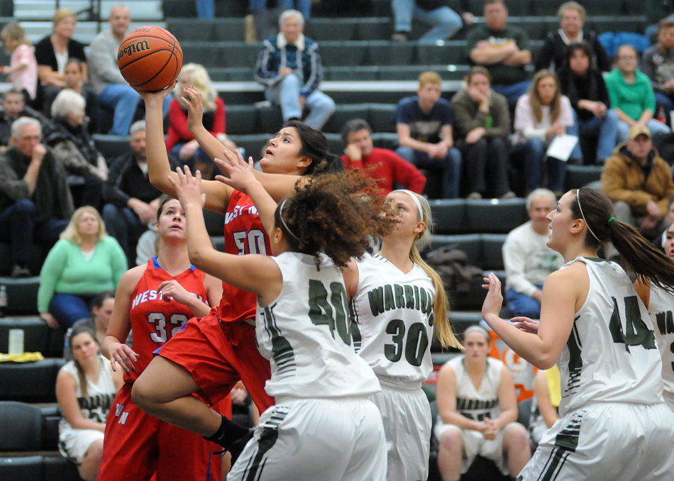 West Noble's Sandra Carrillo drives in for a shot attempt against Wawasee.