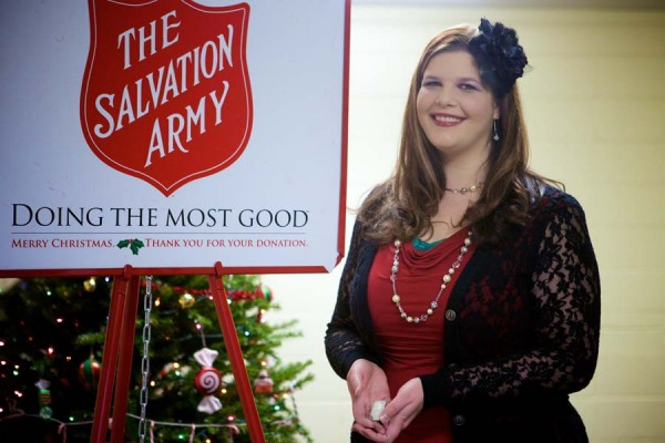 Melissa Cunningham, Kettle Campaign Coordinator for The Salvation Army, holds a .999 fine silver on troy ounce coin found in a counter kettle.
