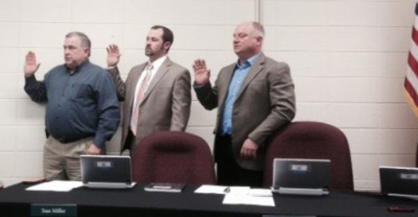 Bryan Murphy, Stan Miller and Todd Hoffman take the oath of office. (Photo by Jarrett Van Meter)