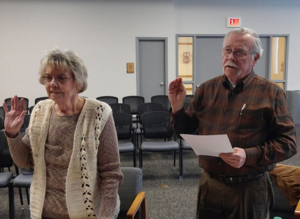 Shelia Bruner and Joe Streeter take the oath of office for Warsaw-Wayne Township Fire Territory Advisory Board. (Photo by Deb Patterson)