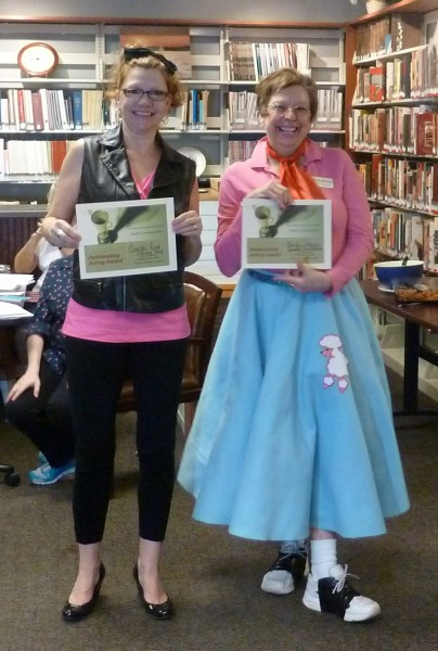 """Missy Sorg and Janette Stackhouse were recognized for the best costumes at the library's """"Murder on the Dance Floor"""" 1950's mystery dinner."""