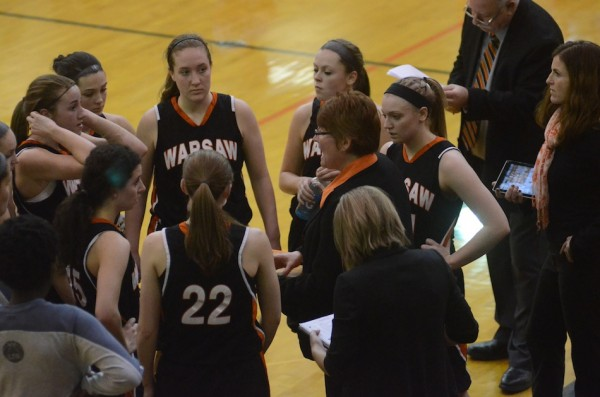 Coach Michelle Harter gives instructions to her Warsaw team during a timeout in the fourth quarter Saturday.