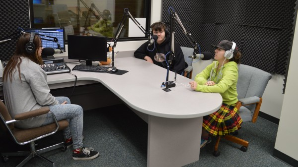 From left, Wawasee High School students Cheyenne Clark, Jeremy David Cates and Erica Grotz are at microphones in the new radio studio at the high school. Warrior Radio WRWT 93.7 FM has been on the air since Dec. 1.