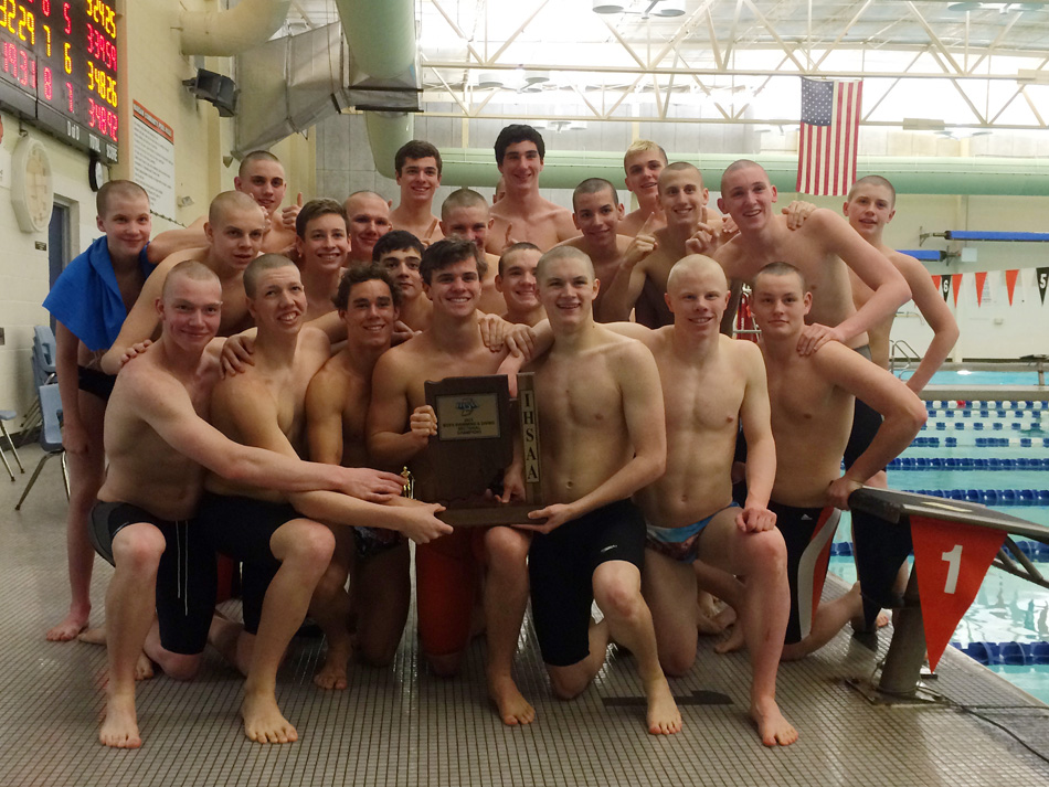 The Warsaw boys swim team pose with the sectional trophy after taking the Warsaw Boys Swim Sectional Saturday afternoon, it's eighth straight sectional team championship. (Photos by Mike Deak)