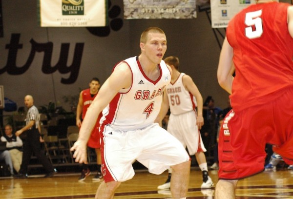 Grace's Logan Irwin defends during a second-round game Friday in the NAIA Tournament. The Lancers dropped a 68-62 final to Southern Oregon (Photo provided by Brian Beery)