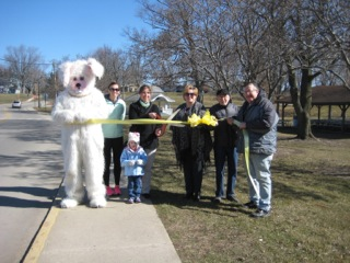 The Syracuse-Wawasee Trails Committee held a ribbon cutting ceremony for the opening of the new trail around Syracuse Lake and the surrounding area. Pictured from left are: the Easter Bunny; Jodi Buhrt, Trails Committee member; Amara McClellan;  Megan McClellan, Trails Committee executive director; Holly Swoverland, K21 Foundation; Mike Buhrt, former chairman of the Trails Committee; and Jerry Wright, Trails Committee member. (Photo provided)
