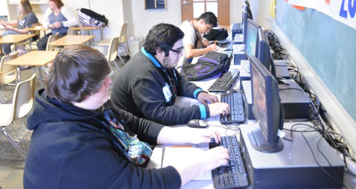 WCHS JAG students Zach Hall and Alex Arzola research the NCAA tournament field. (Photo by Jarrett Van Meter)
