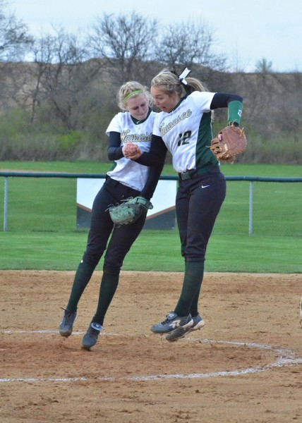 Amber Lemberg (left) celebrates with Meghan Fretz (right) after retiring a batter during Monday's 4-1 win over Northridge. (Photos by Nick Goralczyk)