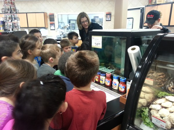 """Students learn about """"Larry the lobster"""" while visiting Martins Supermarket."""
