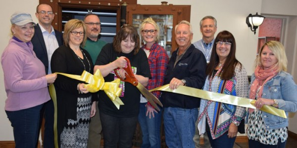 Cutting the ribbon in front, from left, are Sylvia Gargett, Tammy Cotton,  Natalie Abigail,  Dave Mayer, Kathleen Boyts and Kristy Rumfelt. In back are, Heath Simcoe, Chris Cotton, Kristi Martin and Steve Peer. (Photo by Chelsea Los)