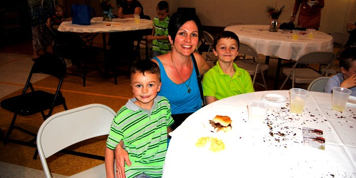 Missy Likens and sons, Zane, 6, and Grant, 9, enjoy food at tonight's Mommy Son Dance in Syracuse.