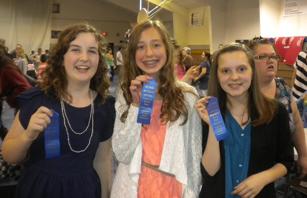 "Pictured are 6th grade Superior ribbon winners Joy Hanes, Avery Hobbs and Rachel Dempsey. Joy Hanes' speech ""The Joy of the Lord"" and Avery Hobbs' speech ""The Cornerstone of our Society"" were student-written original speeches. Rachel Dempsey's speech was entitled "" Temperance & Women's Rights."""