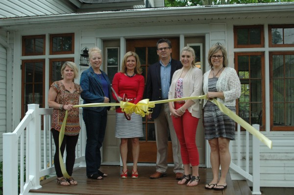 Present at the ribbon cutting ceremony were, from left, Wawasee-Syracuse Chamber of Commerce members Kristy Rumfelt, Sylvia Gargett, Reecer Properties President Lynn Reecer, Vice President James Reecer, Lakes Transaction Coordinator Kate Leach, Executive Director of Syracuse-Wawasee Chamber of Commerce Tammy Cotton. (Photo by David Hazledine)