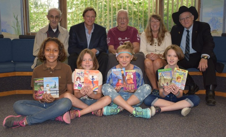 Front row, from left, are fourth-grade students Aaliyah Hire, Alisha Mansfield, Jade Hentzell and Trinity LaJoice. In the back row are Rotary members Paul Schmucker, Robert Smith, Charlie Harris, Kim Conrad and Dr. Richard Brungardt.