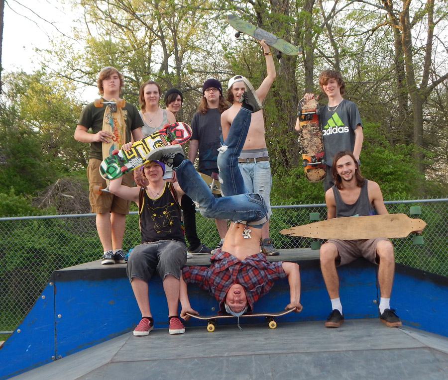 Syracuse Skate Park was filled with teens on skateboards and bikes last week as the temperatures reached season highs. Kris Marquart is surrounded by friends as he does a hand stand on his board.