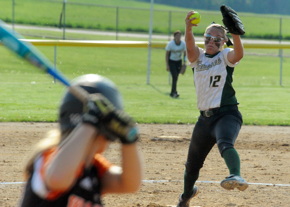 Wawasee pitcher Meghan Fretz was dealing aces all night against Warsaw, allowing just three hits and one run in Wawasee's 11-1 victory. (Photos by Mike Deak)
