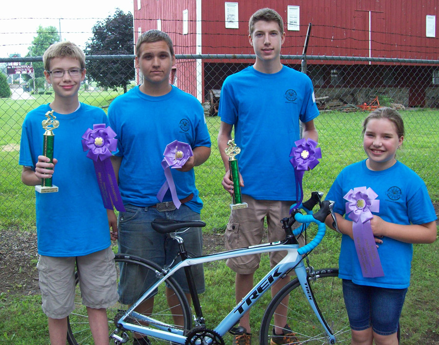 The photo shows the division winners , from left, are: Isaac Inniger, New Paris, junior division champion; Alec Calkins, Elkhart, senior division reserve champion; Sr. Division Champion – Lucas Inniger, New Paris, senior division champion; and Paige Jacobs, Nappanee, junior division reserve champion.