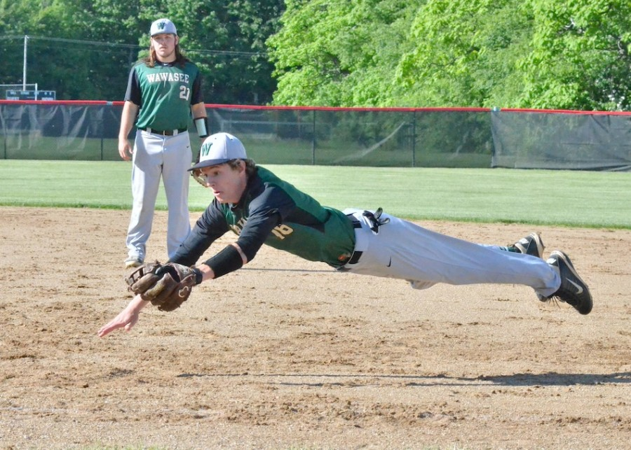 Gage Reinhard makes an incredible play at first base trying to beat a runner in the sixth inning of Wawasee's loss to NorthWood. (Photos by Nick Goralczyk)