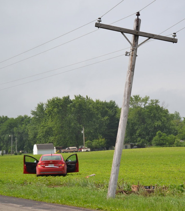 This vehicle reportedly became airborne while crossing the railroad tracks, sideswiping another vehicle and hitting a utility pole