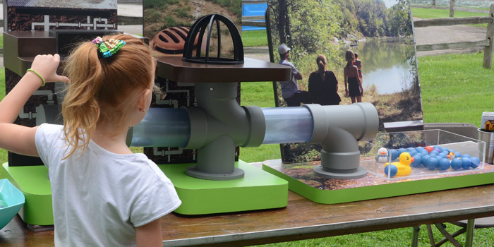 The Tippecanoe Watershed Foundation had a storm drain simulator available to learn where items going into storm drains end up.