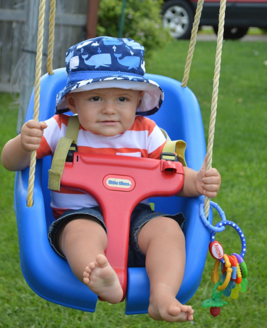 Caiden Beeler, age 1, wears a sun hat as he enjoys a ride in his swing. It's a good idea to start children early in sun protection to help reduce the chances of skin cancer when they're older. Some of those habits include wearing a hat and sunglasses and putting on sunscreen.