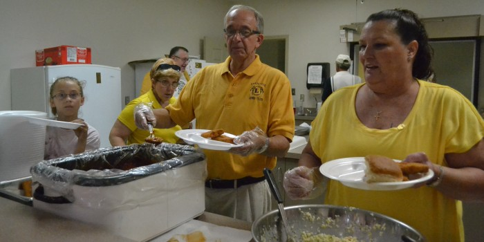 From left, Jennifer Brace, Tom Thornburg and Sandra Mignery make up the serving line at the Syracuse Lions Club's annual Jonah Fish Fry. (Photo by Sarah Wright)