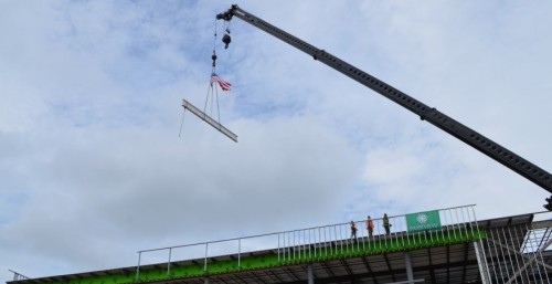 A crane hoists the final beam in the construction of the new Parkview Warsaw facility during Wednesday's topping-out ceremony. (Photo by Amanda McFarland)