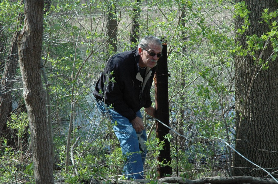 In this file photo, Dick Kemper, Kosciusko County Surveyor, is shown doing field work near Lake Papakeechie as part of locating a section corner marker. Kemper announced he is resigning as county surveyor effective Aug. 14.