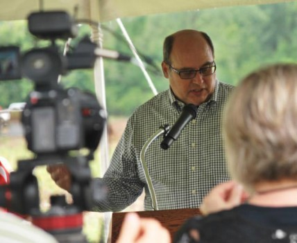 Co-founder and president of Poly-Wood, Inc., Doug Rassi, speaks at the ground breaking ceremony Thursday, June 25.