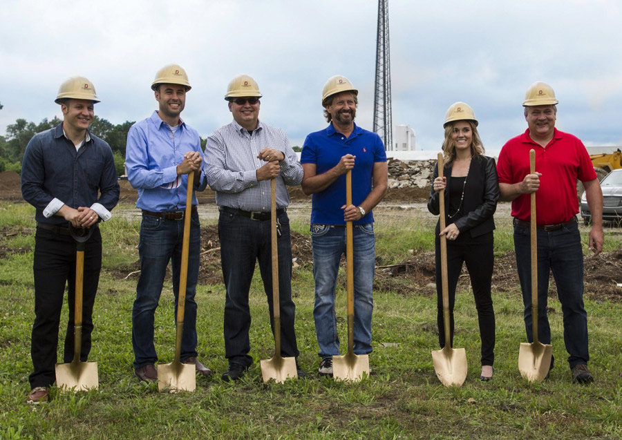 Breaking ground, from left are Brady Maller, vice president of strategy and development; Sean Rassi, vice president of dDesign and technology; Doug Rassi, co-founder and president; Mark Phillabaum, co-founder and vice president of strategic sales; Megan Pierson, director of sales and marketing; and Ross Munn, generalmanager