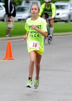 Erin Rivich competes in the 2015 Warsaw Optimist Triathlon in Winona Lake. The Warsaw Parks and Recreation Department as well as the Warsaw Breakfast Optimist Club are hosting a Kid's Triathlon Clinic. (File photo by Mike Deak)