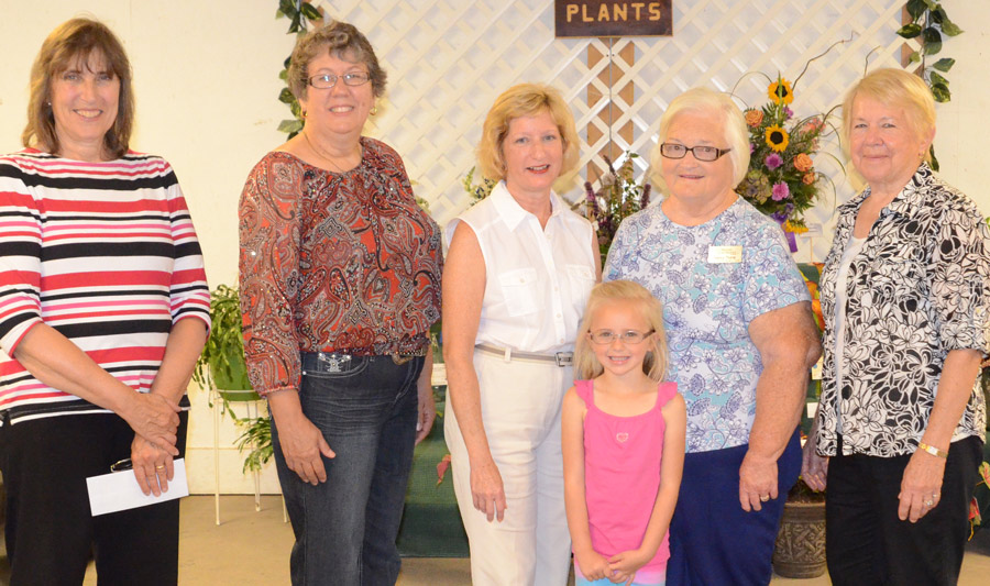 Winners shown in the flowers division, form left, are Sandy Wise, superintendent; Deb Schroeder, best of show; Carol Edmunds; Kinley Crabb; Nancy Trump; and Roberta Tucker.