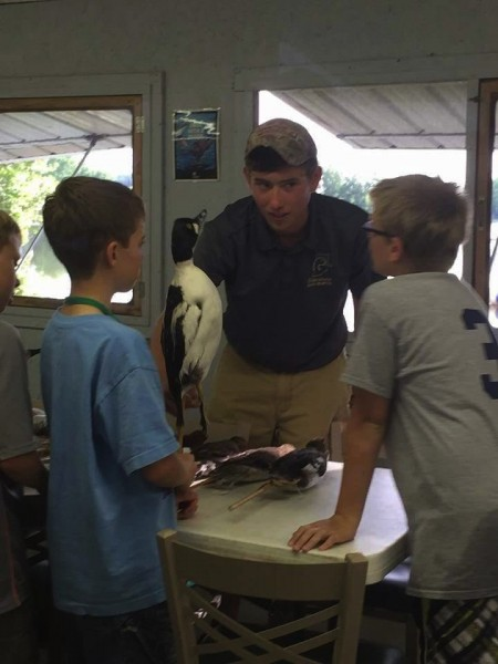 Wawasee DU member Bailey Hershberger (center) helps out at Camp Mollenhour.