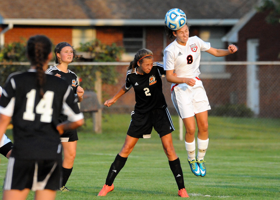 NorthWood's Arika Flickinger heads away a cross from Warsaw's Anna Grill Thursday during Warsaw's 4-0 win. (Photos by Mike Deak)