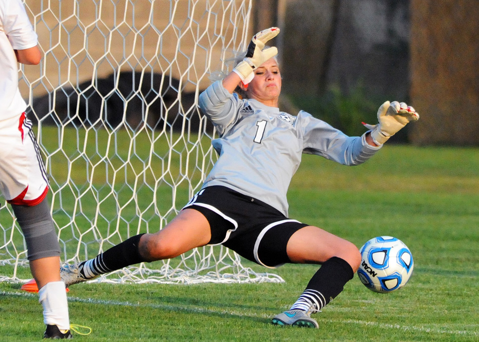 NorthWood keeper Madi Eberly flies in to make a save on a Warsaw shot in the first half.