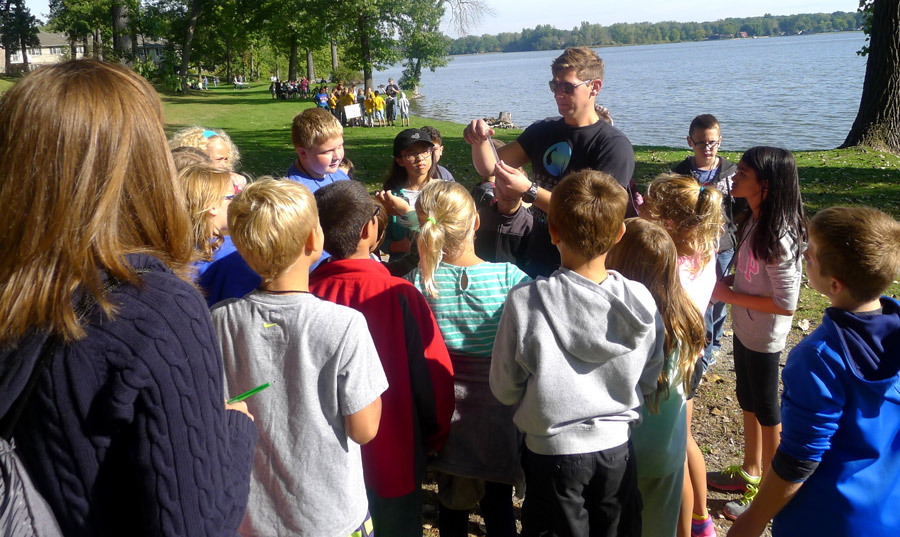 Center for Lakes & Streams' staff member, Seth Bingham, teaches students how to test lake water for pH, oxygen, and nitrate levels.