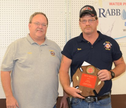 Burket Fireman Dave Sheets, right, was named the 2015 Kosciusko County Fireman of the Year. He is shown with Kevin McSherry, county association president and Burket Fire Chief. (Photo by Deb Patterson)