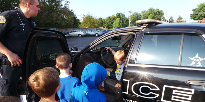 Pictured is Officer David Swain with WCS kindergarten students.