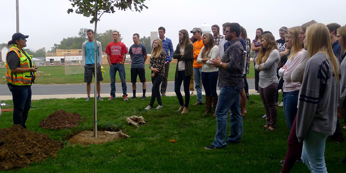 Andrea Nichols, Utility Arborist for NIPSCO and Duke Energy, explains to Grace College General Ecology students the role a tulip tree will play in making Grace College a more environmentally mindful campus.