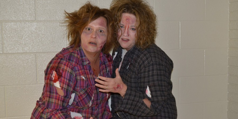 Lisa Knepp, left, and Jodie Roose get into their roles as zombies. (Photo by Sarah Wright)