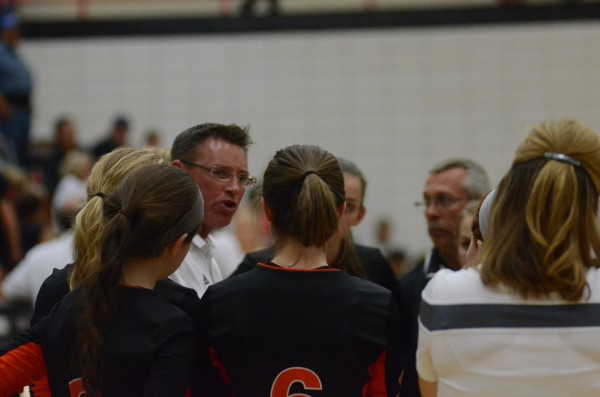 Animated Warsaw volleyball coach Mike Howard makes a point to his team Thursday night.
