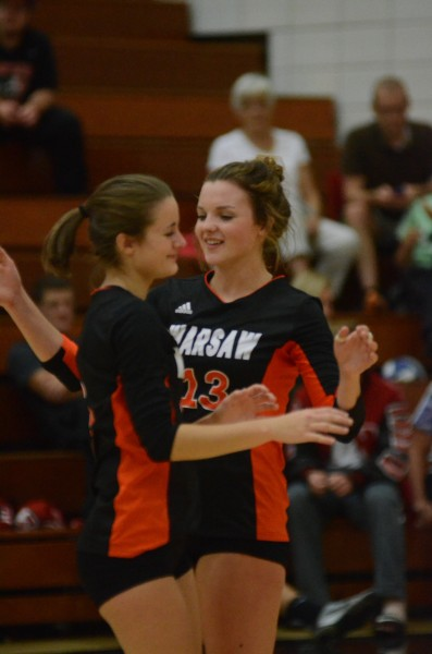Warsaw's Caroline Mayer (right) celebrates with Cassie Hoag during a win at NorthWood Thursday night.