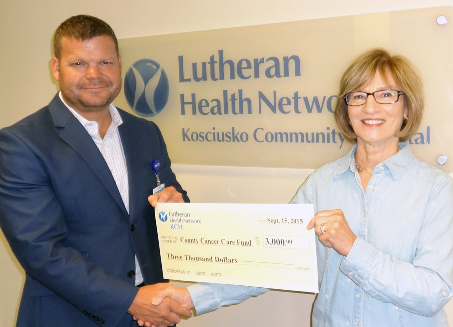 Kirk Ray, new chief executive officer for The Lutheran Health Network/KCH presents a $3,000 check to Pat Ellis, corporate fundraising committee for the Cancer Care Fund of Kosciusko County.