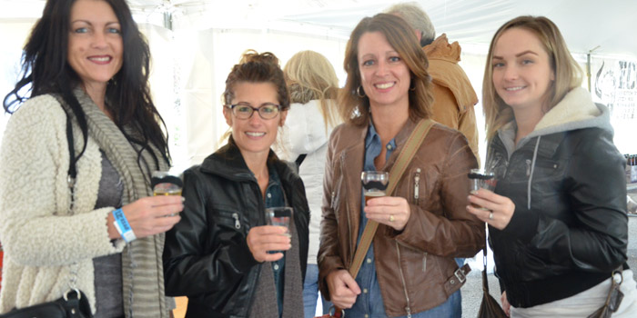 (From left)  Felicia Wolmack, Pierceton; Shanan France, Warsaw; Jessica Schannep, Warsaw; and Katie France, Fort Wayne, enjoy mustache adorned brews during the beer sampling.
