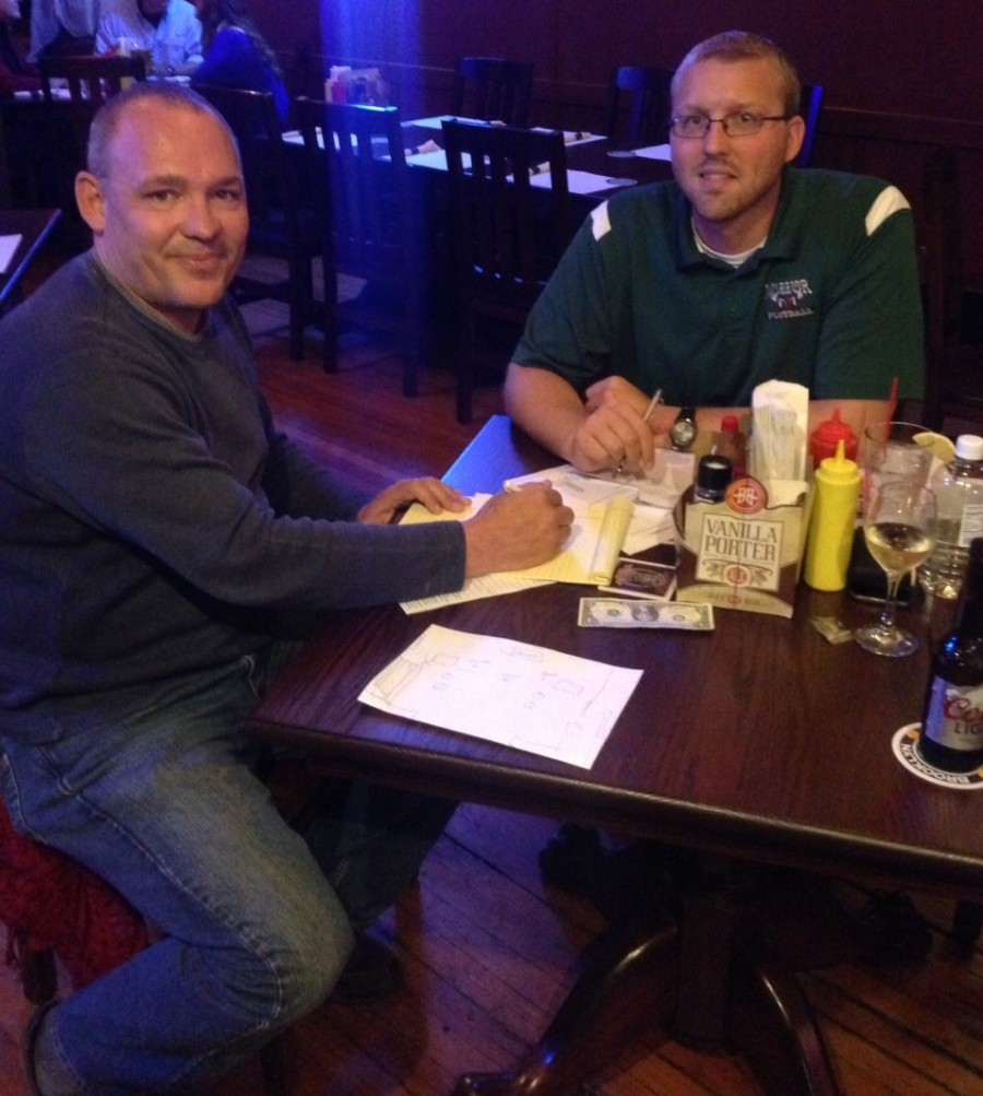 Dave Colquitt, left, and Erick Leffler, both Rotarians, served as members of the Rocktober Fest committee. Here they work on finalizing details prior to the event, Oct. 17. Rocktober Fest will feature live music, food, several raffles, with all proceeds benefiting the North Webster and Syracuse food pantries.