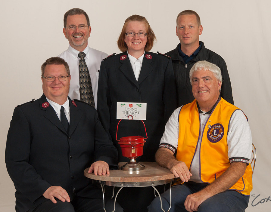Shown in front, from left, are Major Bill Welch and Richard Sisk, Warsaw Lions. In back are, Michael Suhany, Warsaw Kiwanis Club, Major Trish Welch, and Woody Zimmerman, Warsaw Rotary Club. Front row: Major  Not pictured are Warsaw Morning Optimist Club and Kosciusko County Shrine.