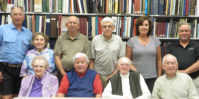 Shown are charter members of the Kosciusko County Historical Society. Seated in front, from left, are Mary Ettinger, John Kleeman, Jerry Lessig and William Landrigan. Standing in back are Michael Klondaris, Betty Stahl, Larry Engle, Carl Diehl, Cindy Klondaris Hampton and Greg Steffe. Charter members not present are: Jack Anglin, Mrs. Donald Boggs, Eddie and Louise Creighton, Max Egolf, Rex Irvine, Donna Keough, Wayne Teeple, Donna Zimmer.  Children signed up by their parents include William, Tim, and Melinda Creighton (Truex); David, Jeffrey, Amy, and Rebecca Keough; Jeff, Dan, and Jenny Strayer; and Kevin Steffe.